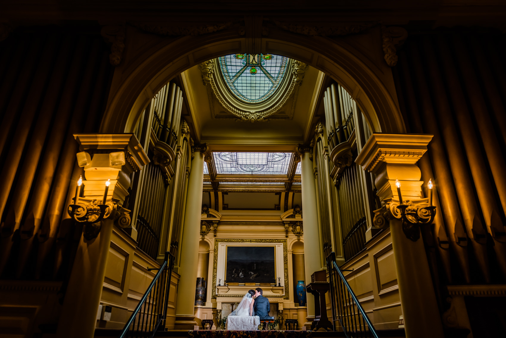 bride and groom sitting in the library at their Glen Foerd Wedding