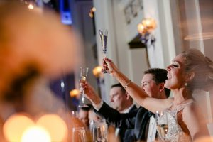 Bride and groom raising their glasses at the Ballroom at the Ben
