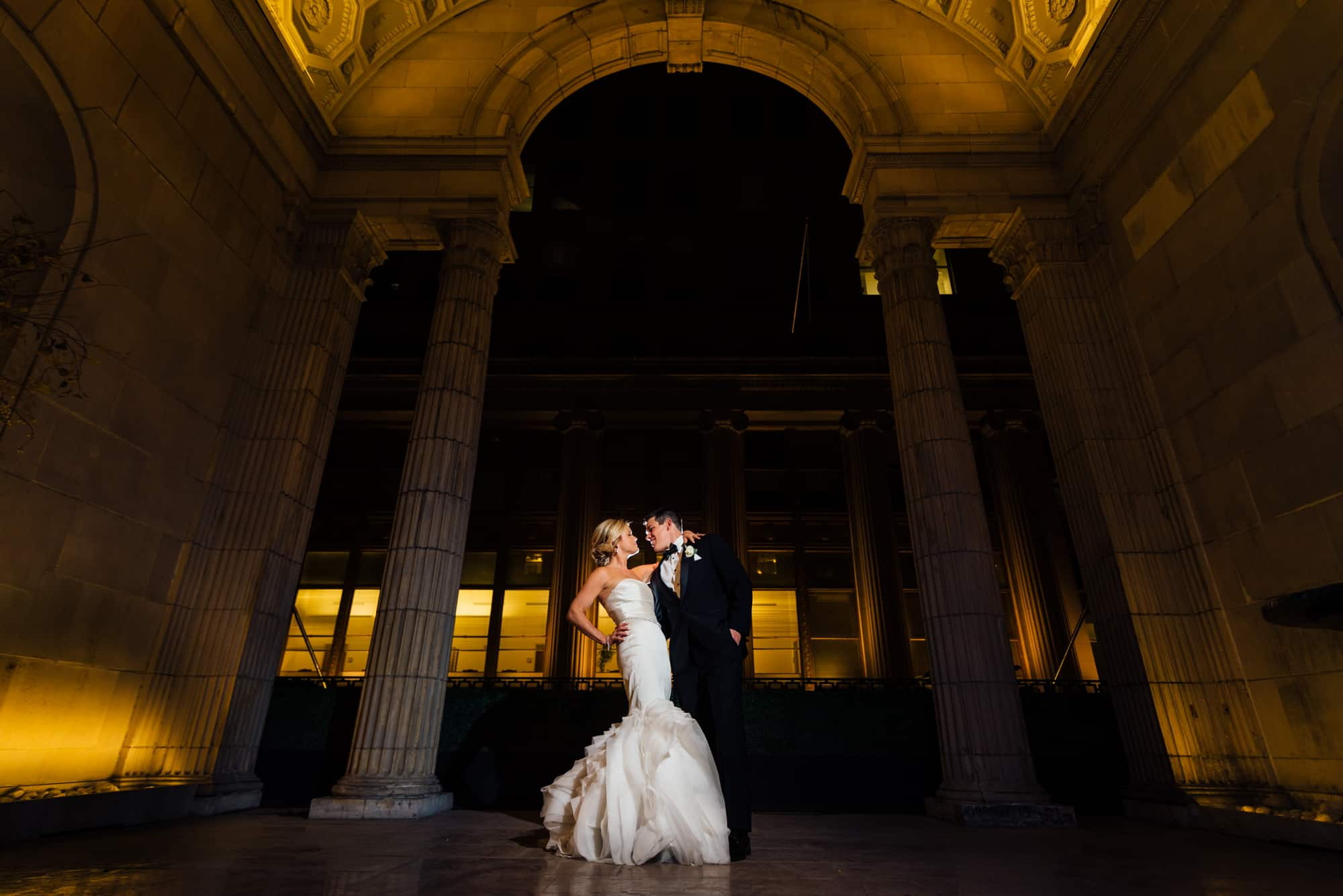 Romantic night image of bride and groom on the terrace of the Ballroom at the Ben