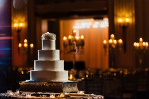 Image of wedding cake with candles in the background