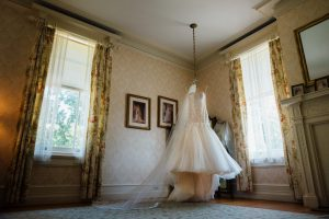 Wedding dress hanging from ceiling at Cairnwood Estate