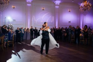 Groom lifting and twirling bride