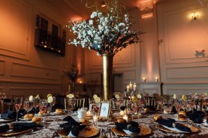 White flower centerpiece on table at wedding reception