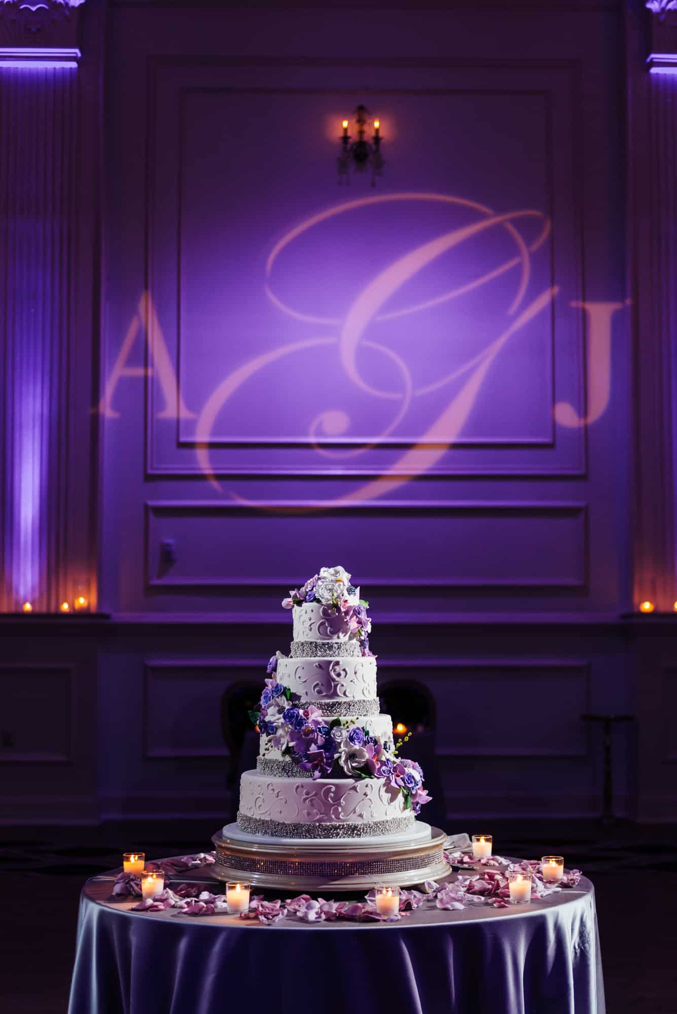 Wedding cake with purple background at Cescaphe Ballroom
