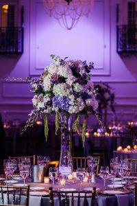 Wedding reception centerpiece with purple background at Cescaphe Ballroom