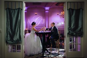 Bride and groom toasting each other at Cescaphe Ballroom