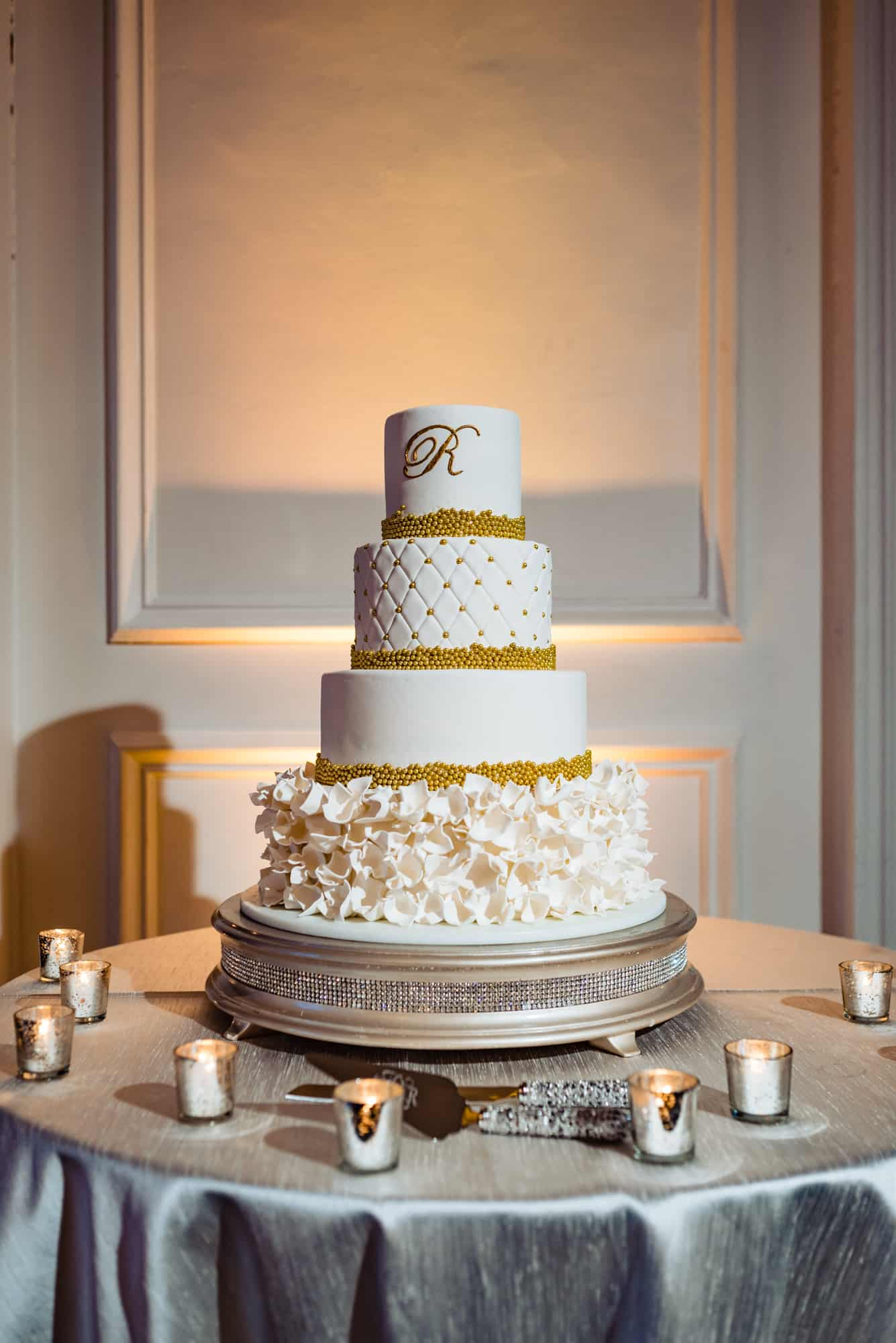 White wedding cake with gold trim