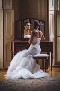 Bride sitting at makeup table at the Glen Foerd Mansion