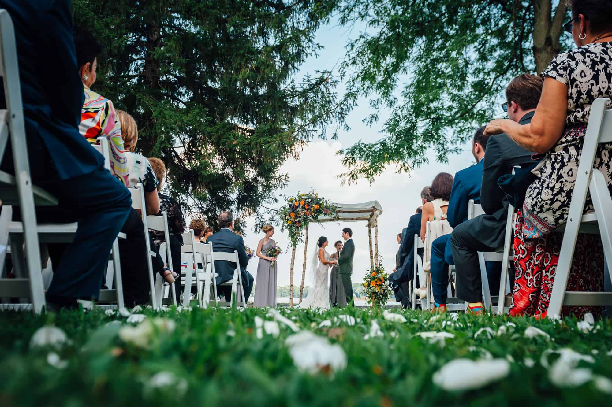 Bride and groom exchanging vows at the Glen Foerd mansion