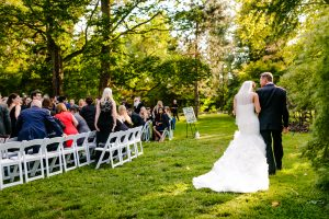 Father escorting bride to outside ceremony at Glen Foerd Mansion