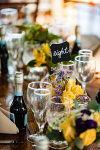 Wedding table detail shot of yellow flowers