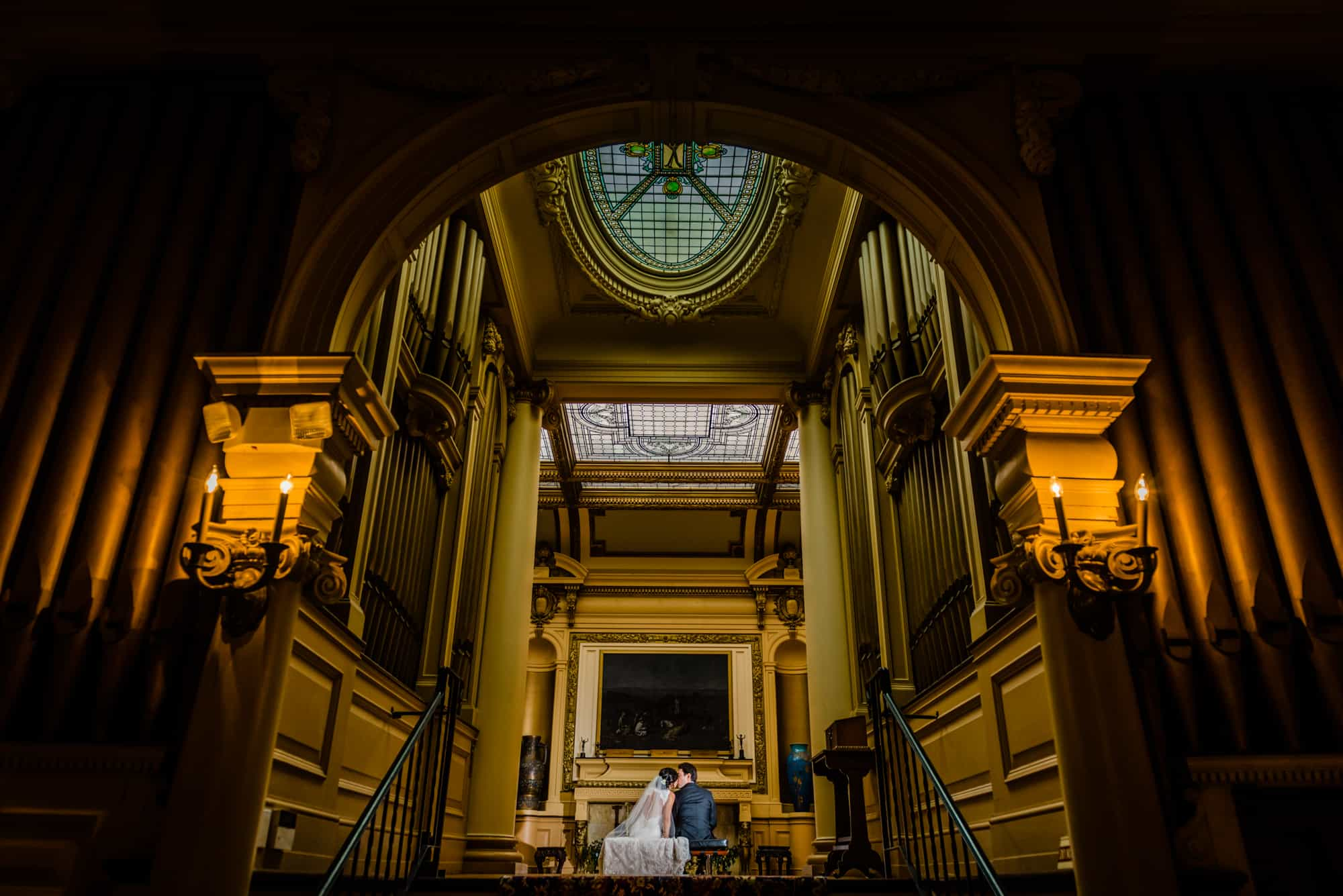 Bride and groom in the library of the Glen Foerd Mansion