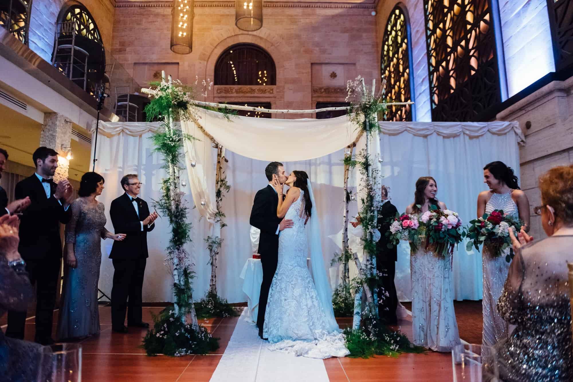 Bride and groom first kiss at Union Trust Philadelphia