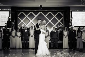 Black and white image of bride and groom dancing at Vie Philadelphia
