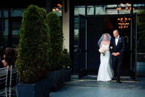 Bride being escorted to ceremony by her father at Vie Philadelphia