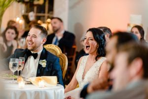 Bride laughing during toasts at Water Works in Philadelphia