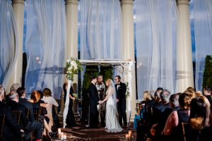 Bride and groom holding hands during ceremony at Water Works in Philadelphia