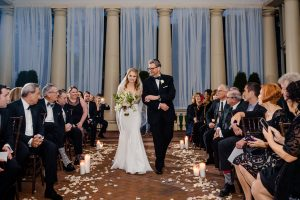 Father looking at bride as he walks her down the aisle at Water Works Philadelphia
