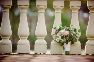 Brides bouquet resting against railing at Water Works Philadelphia