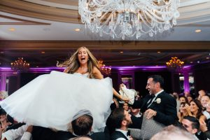 Bride and groom being lifted above crowd at the Westin Hotel