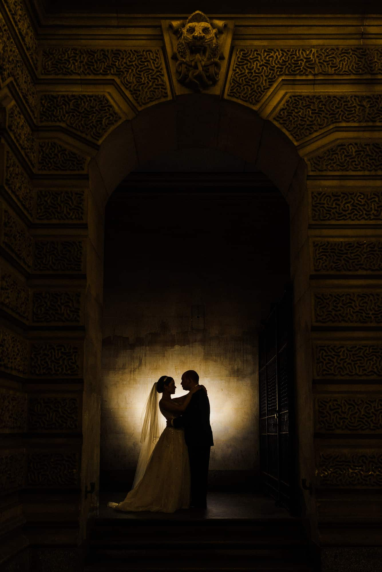 silhoette image of bride and groom in epic wedding shot