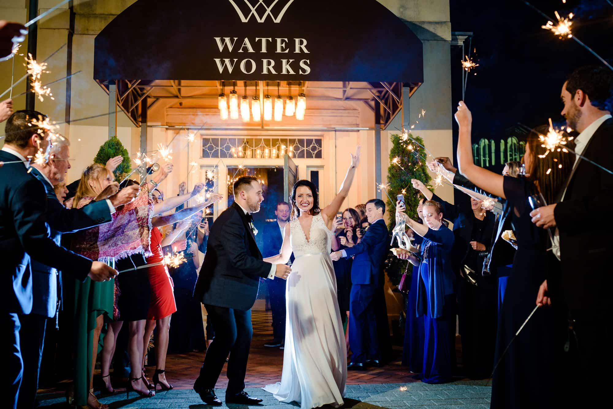 bride and groom exiting reception at the Waterworks in Philadelphia