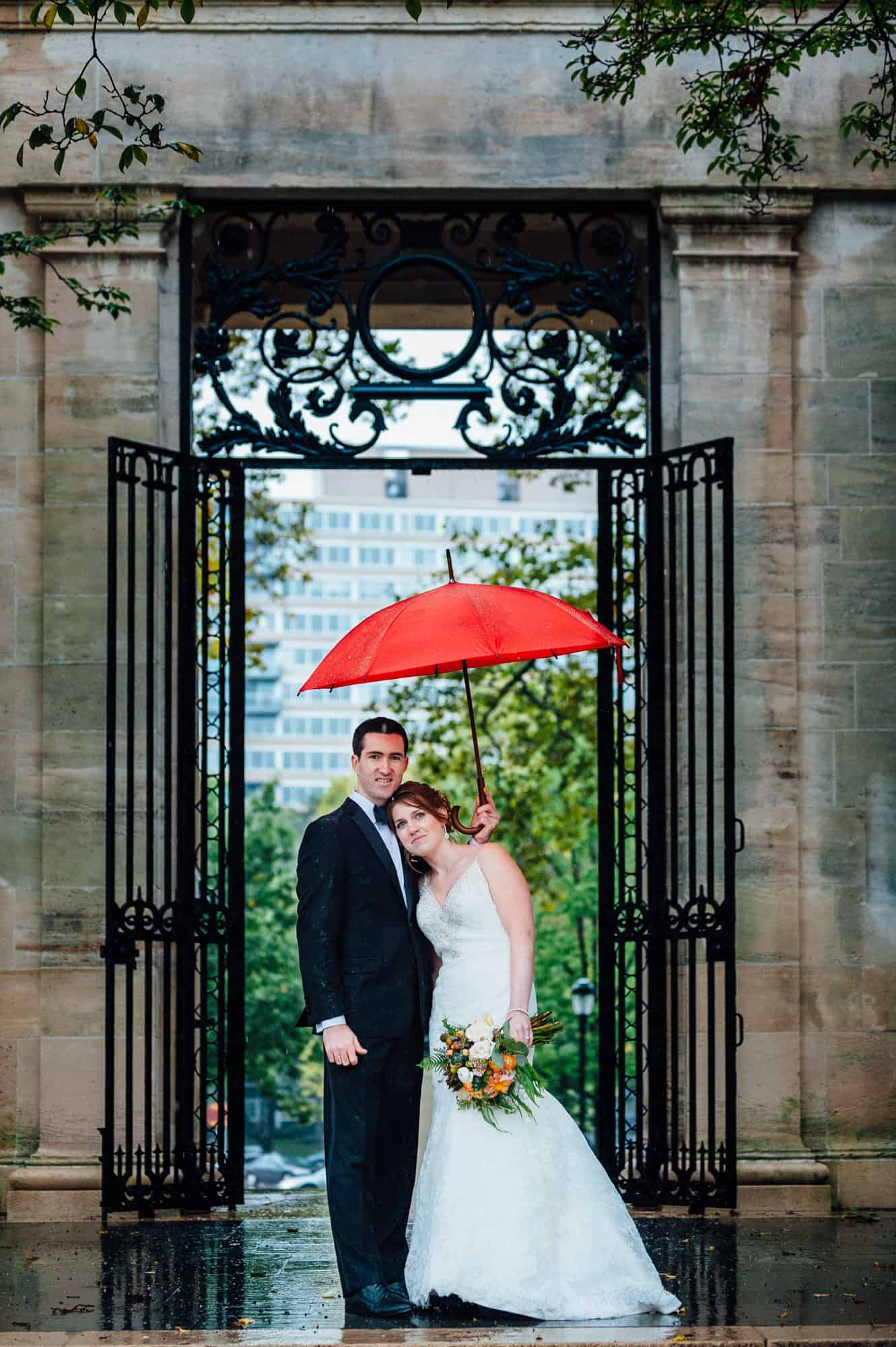 Bride and groom with red umbrella at the Rodin Museum