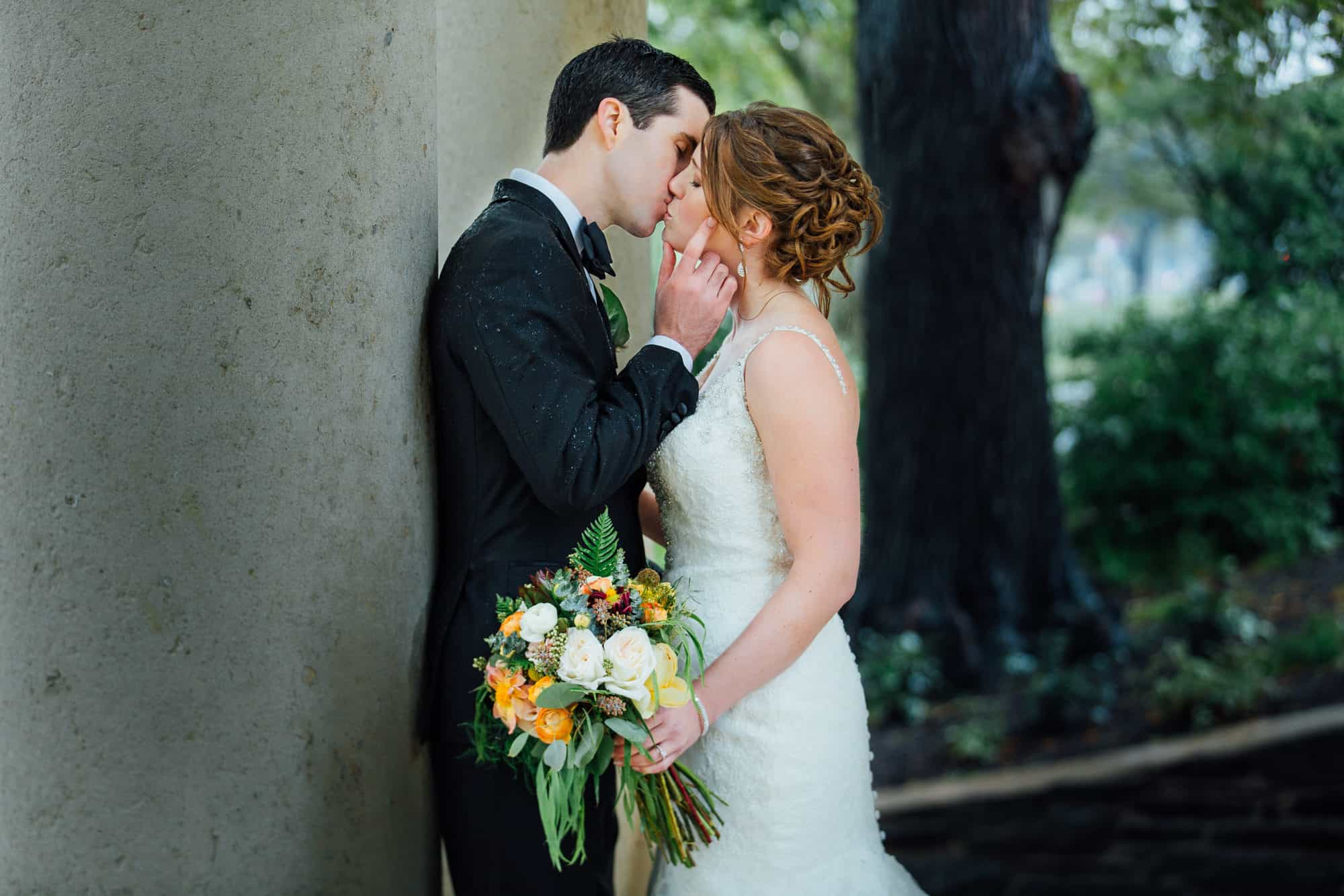 Bride and groom kiss at the Rodin Museum