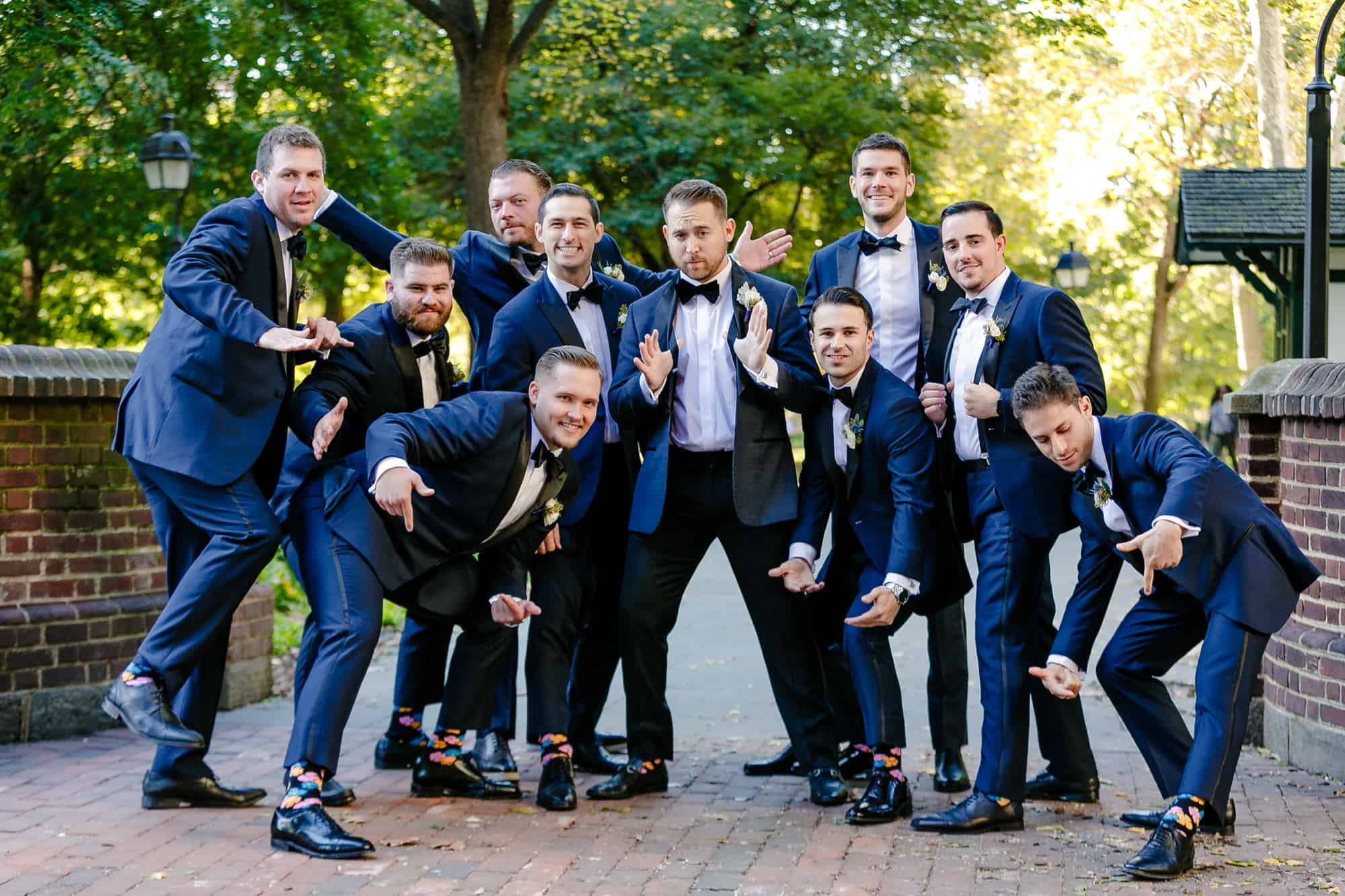 Groomsman posing in Washington Square Park Philadelphia