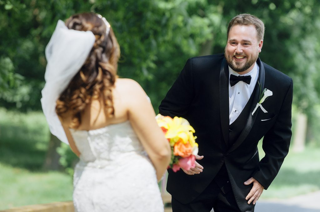 groom smiling after first look with bride