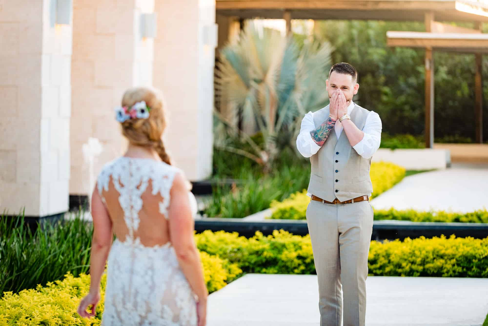 grooms hands to his face after first look with bride