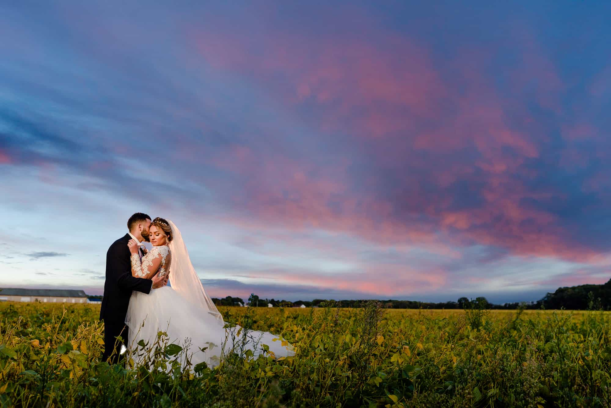 wedding dresses, bride and groom embracing at sunset