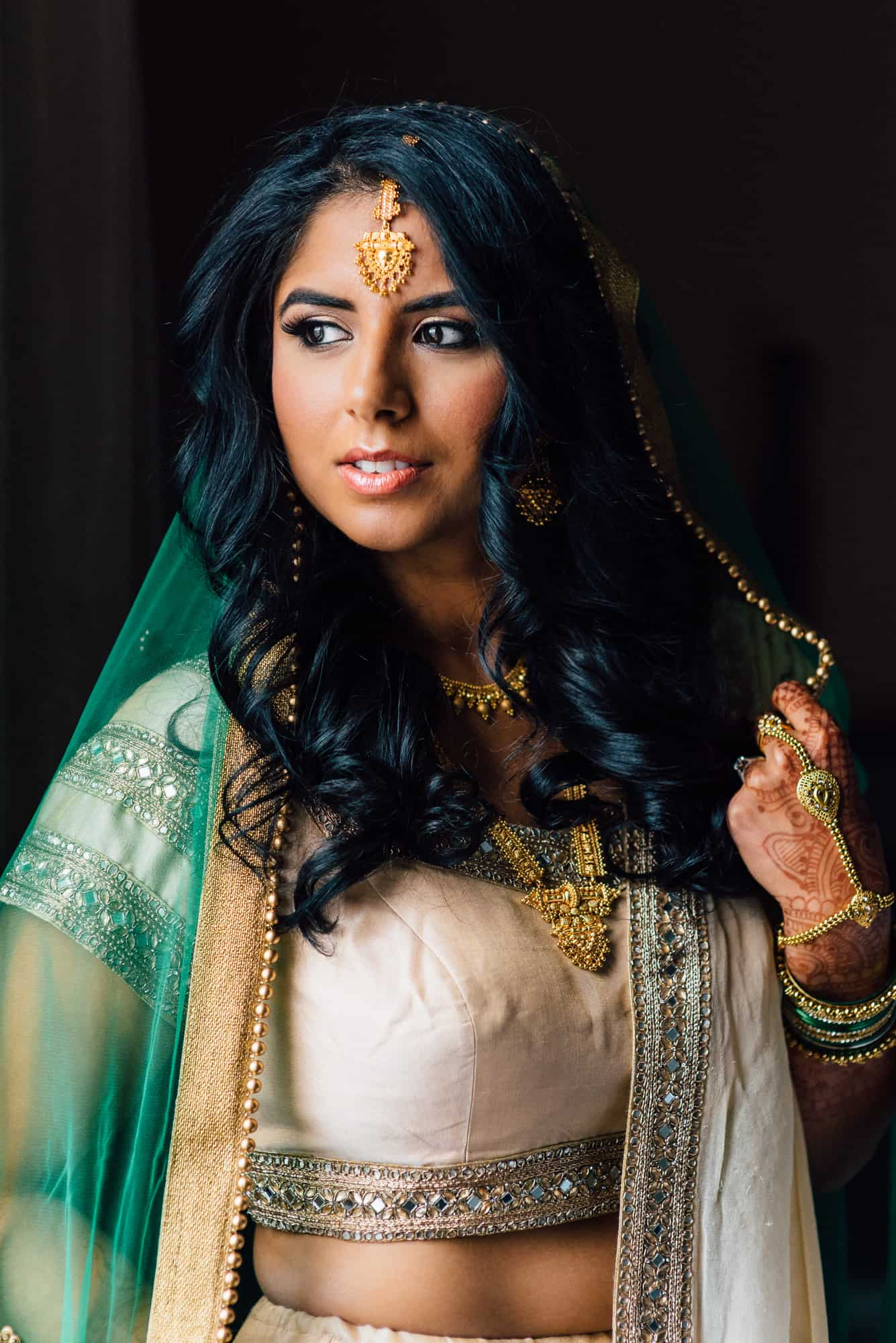 bridal photos, bride in traditional indian dress looking away from camera
