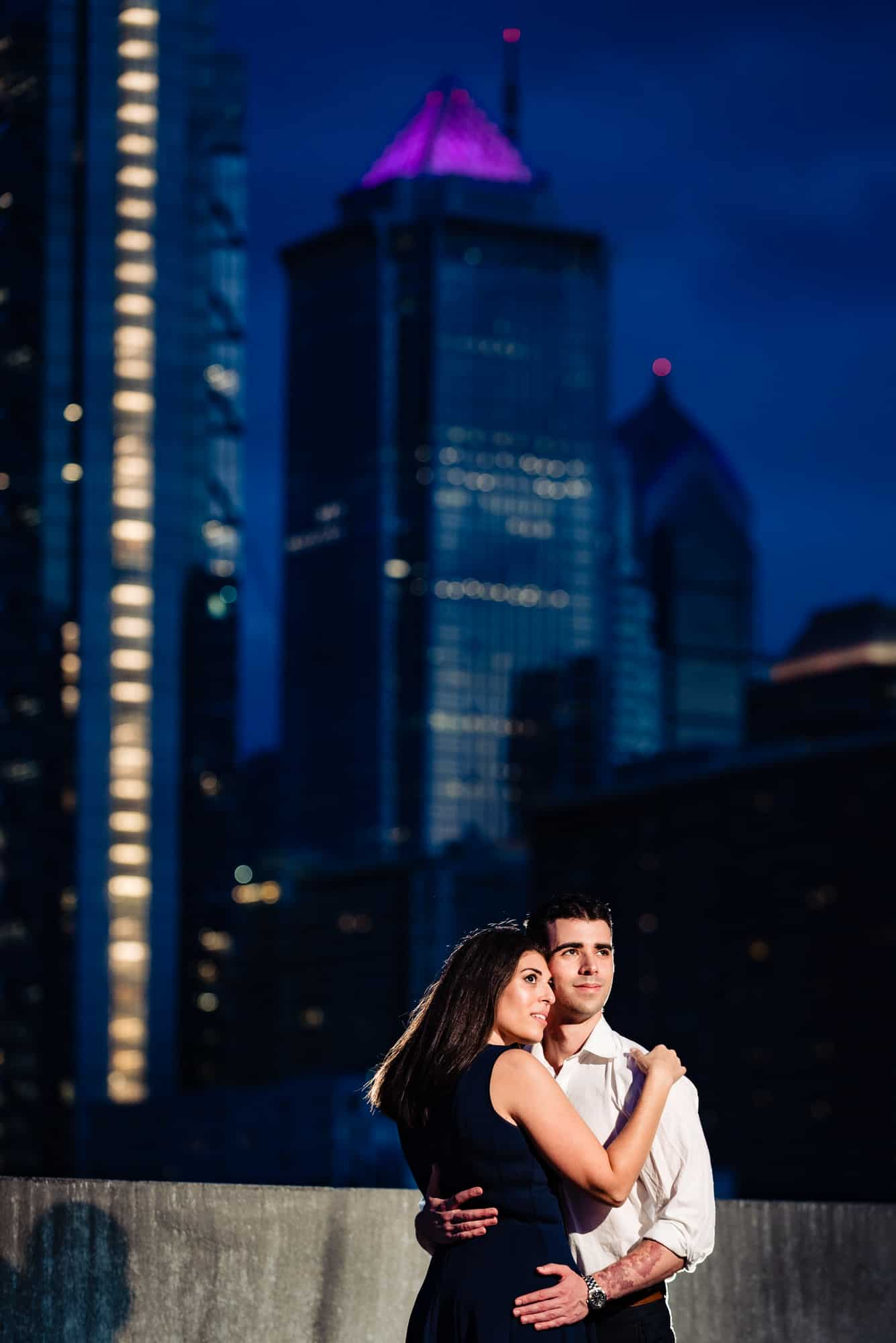 couple embracing on rooftop at night