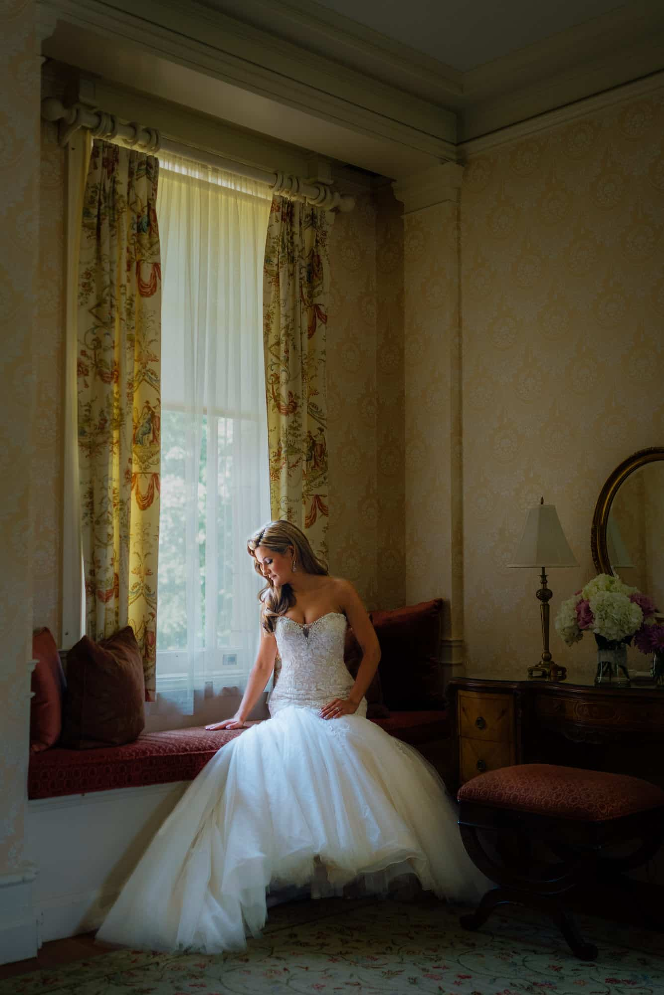 wedding dresses, bride sitting looking out window