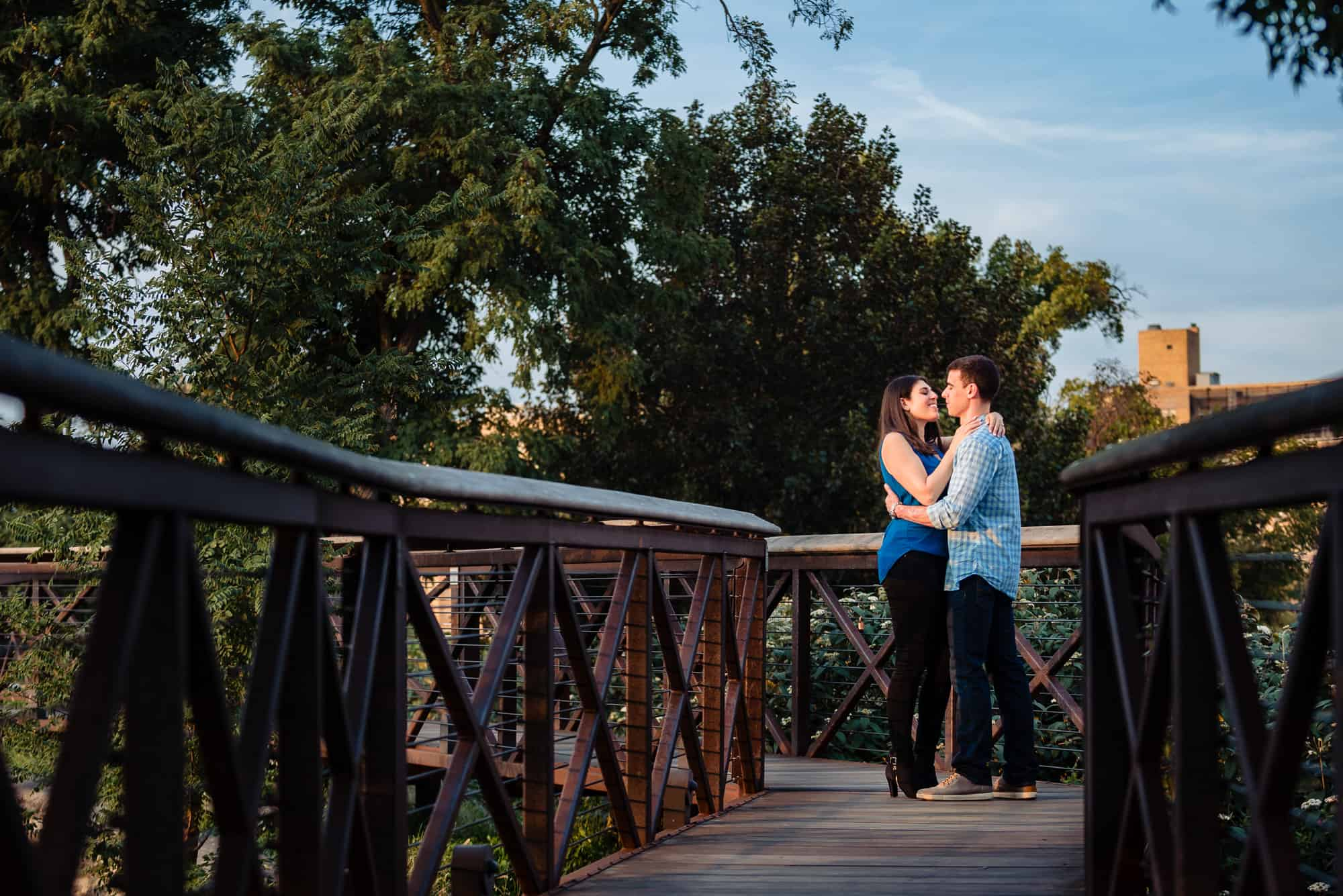 enagagement shoot, couple embracing each other on a bridge