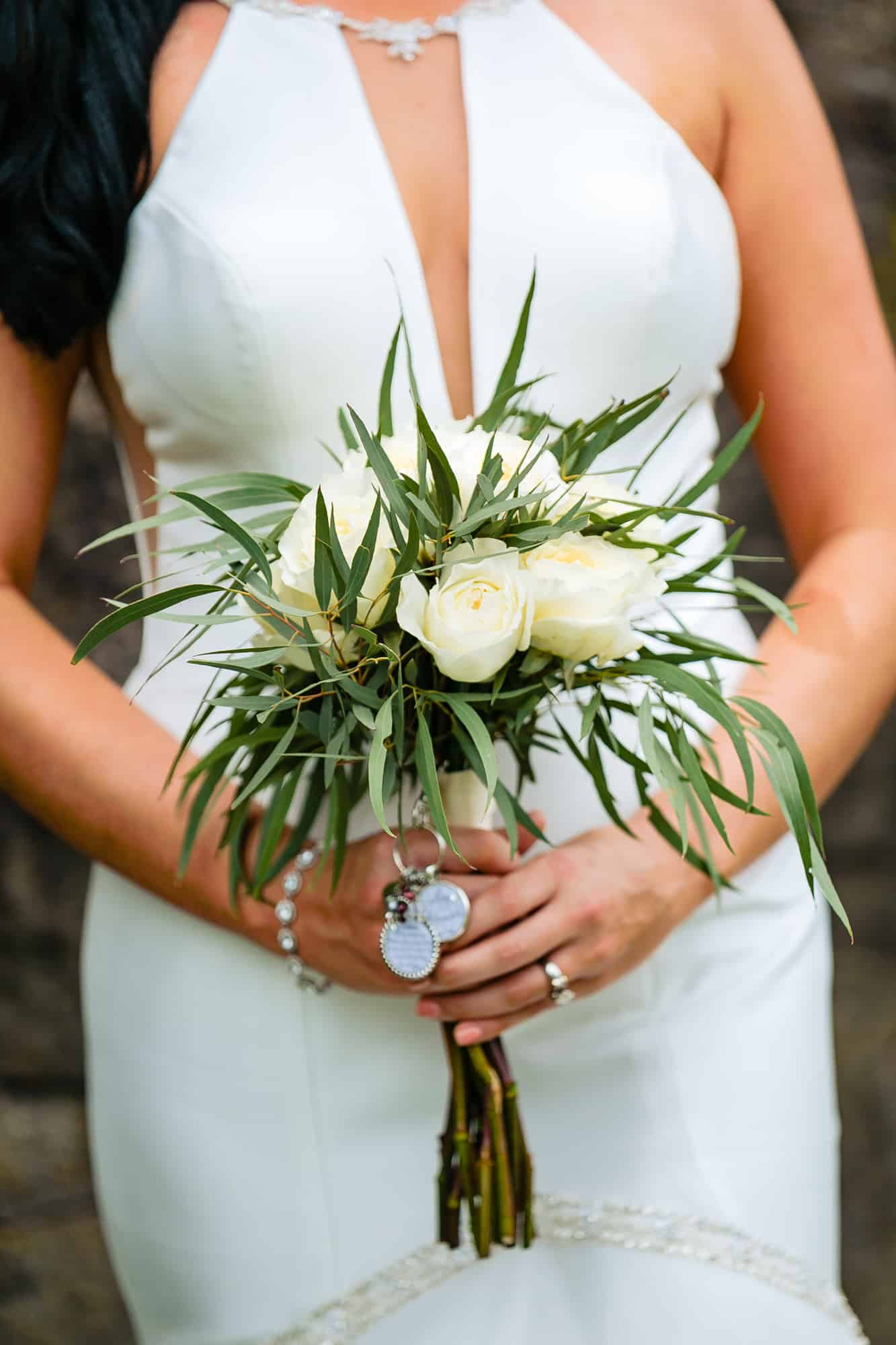 bridal photos, closeup of floral arrangement with simple gown