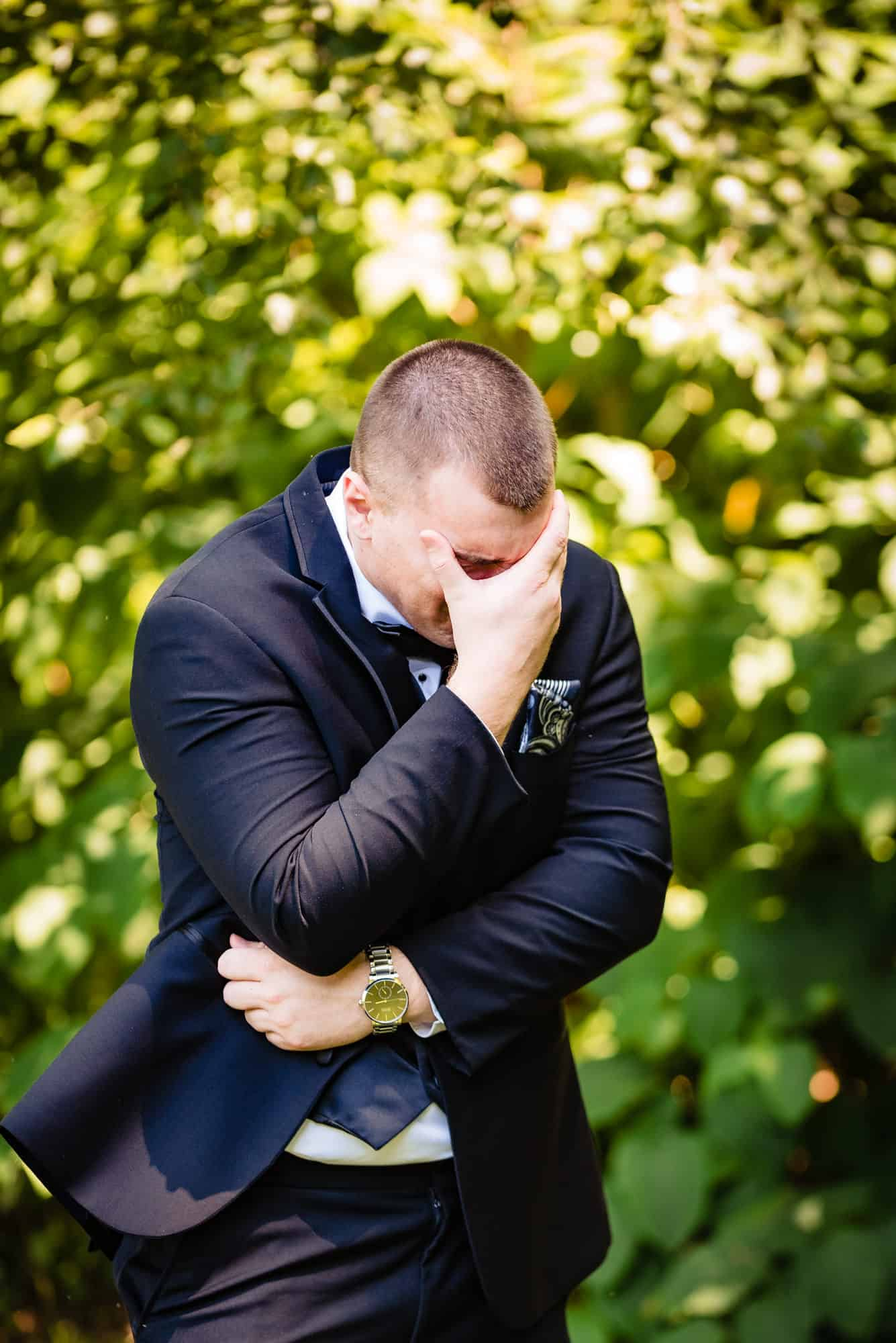 groom emotional after first look with bride