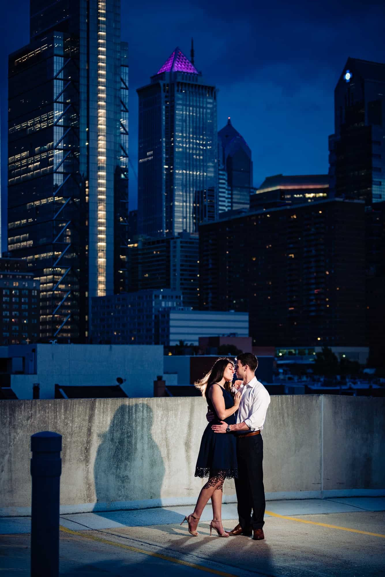 couple kissing on rooftop at night