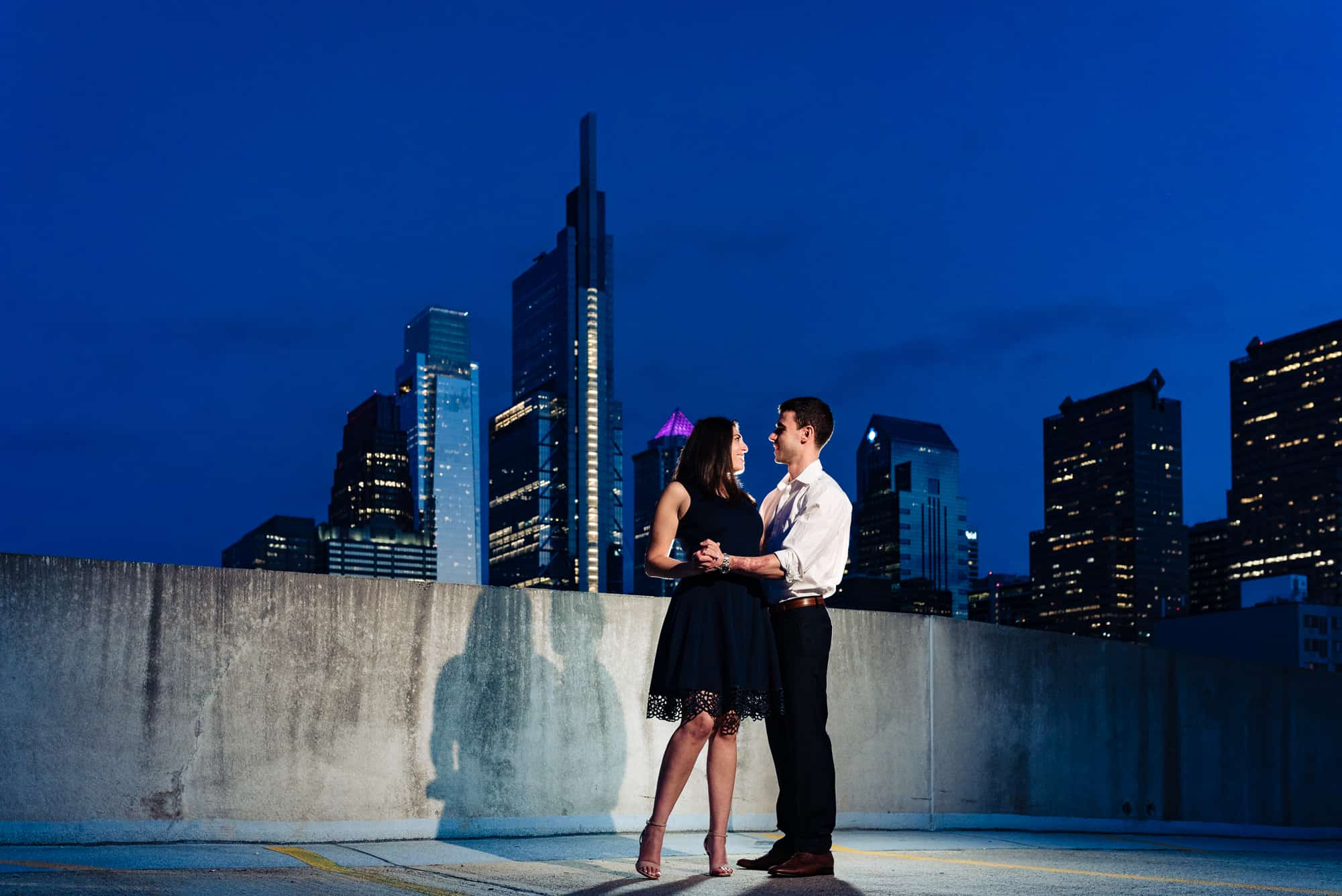 couple dancing on rooftop at night