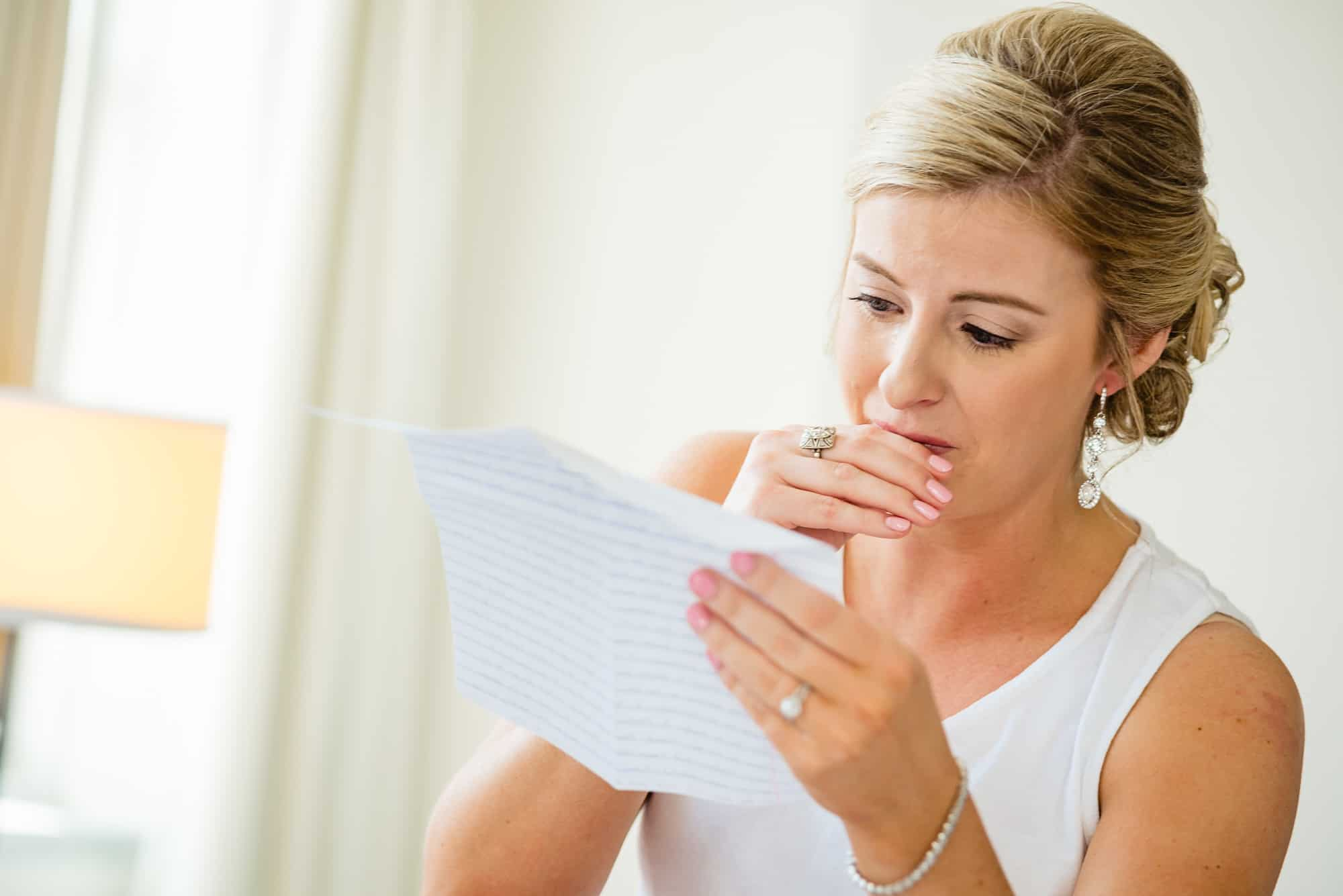 getting ready, bride crying while reading a letter given to her