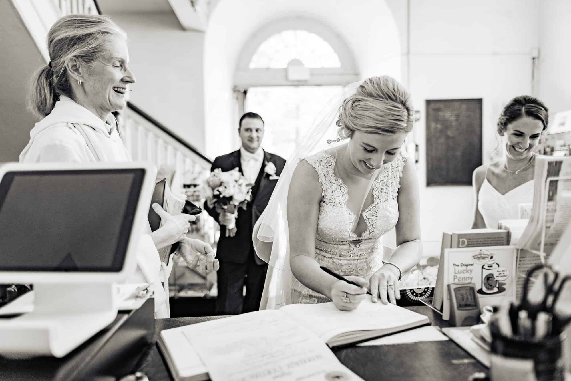 wedding day, bride signing guestbook after the ceremony