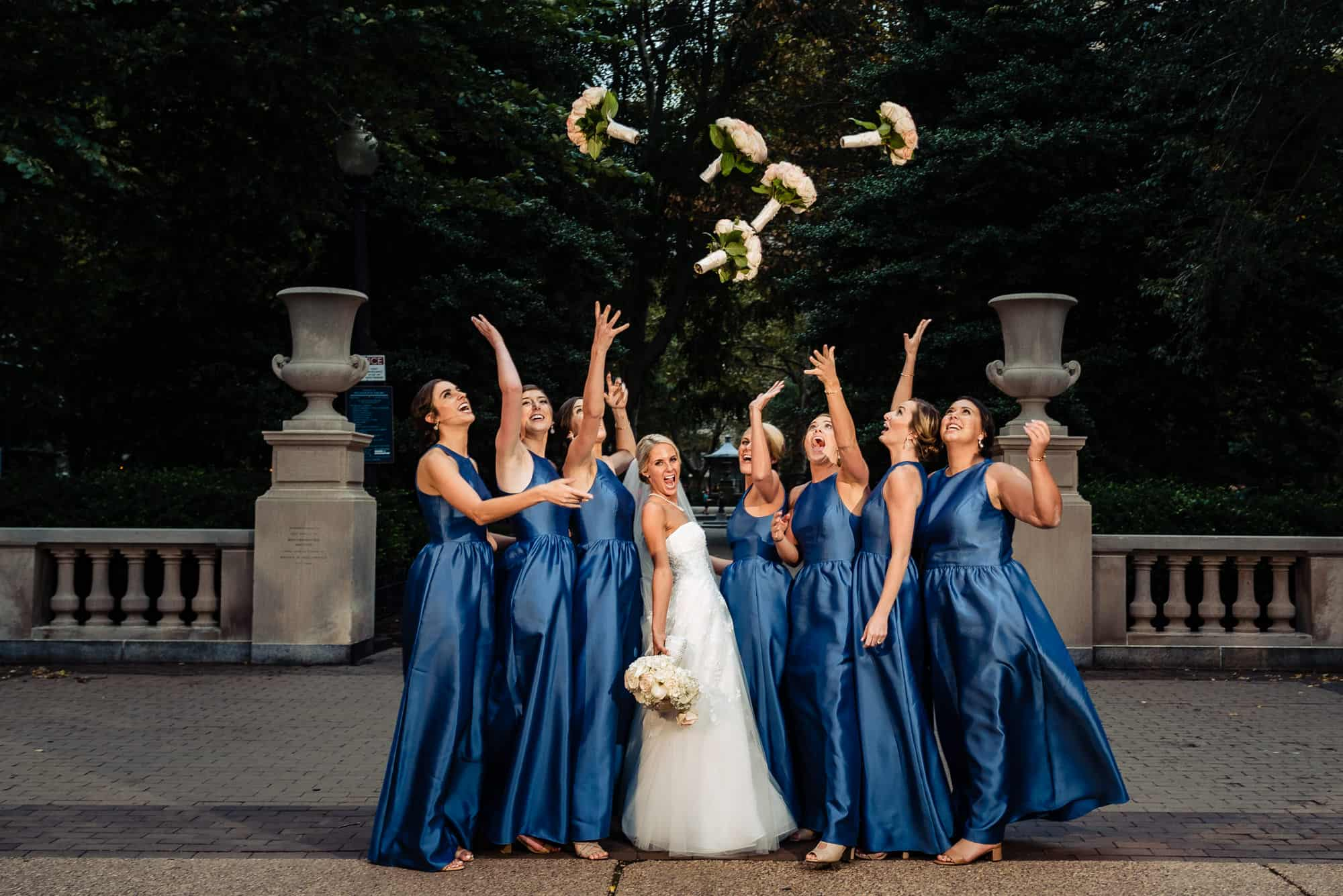 Ritz Carlton Philadelphia Wedding|bridemaids throwing flowers up in the air