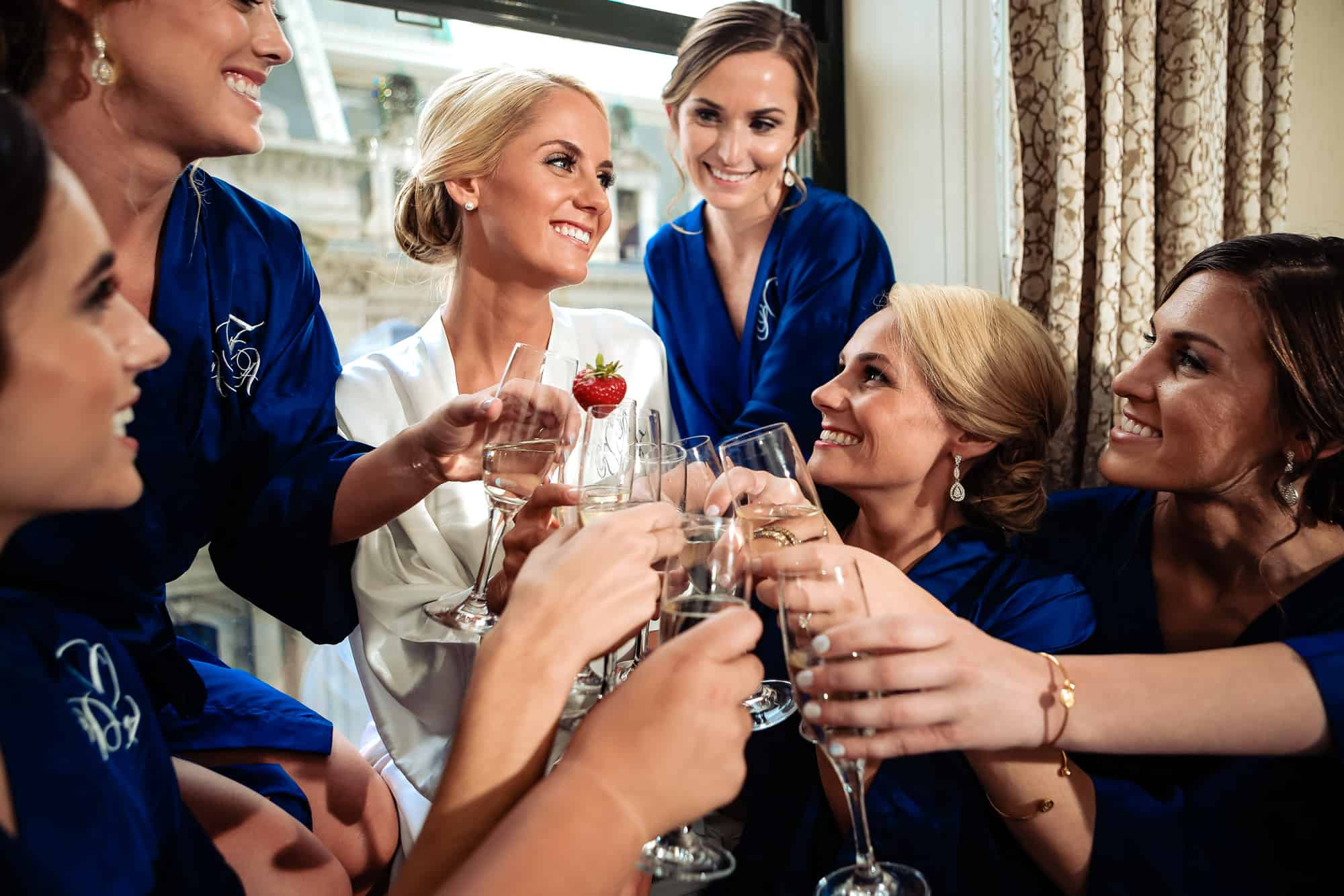 Ritz Carlton Philadelphia Wedding|bride and bridesmaids toasting with champagne glasses