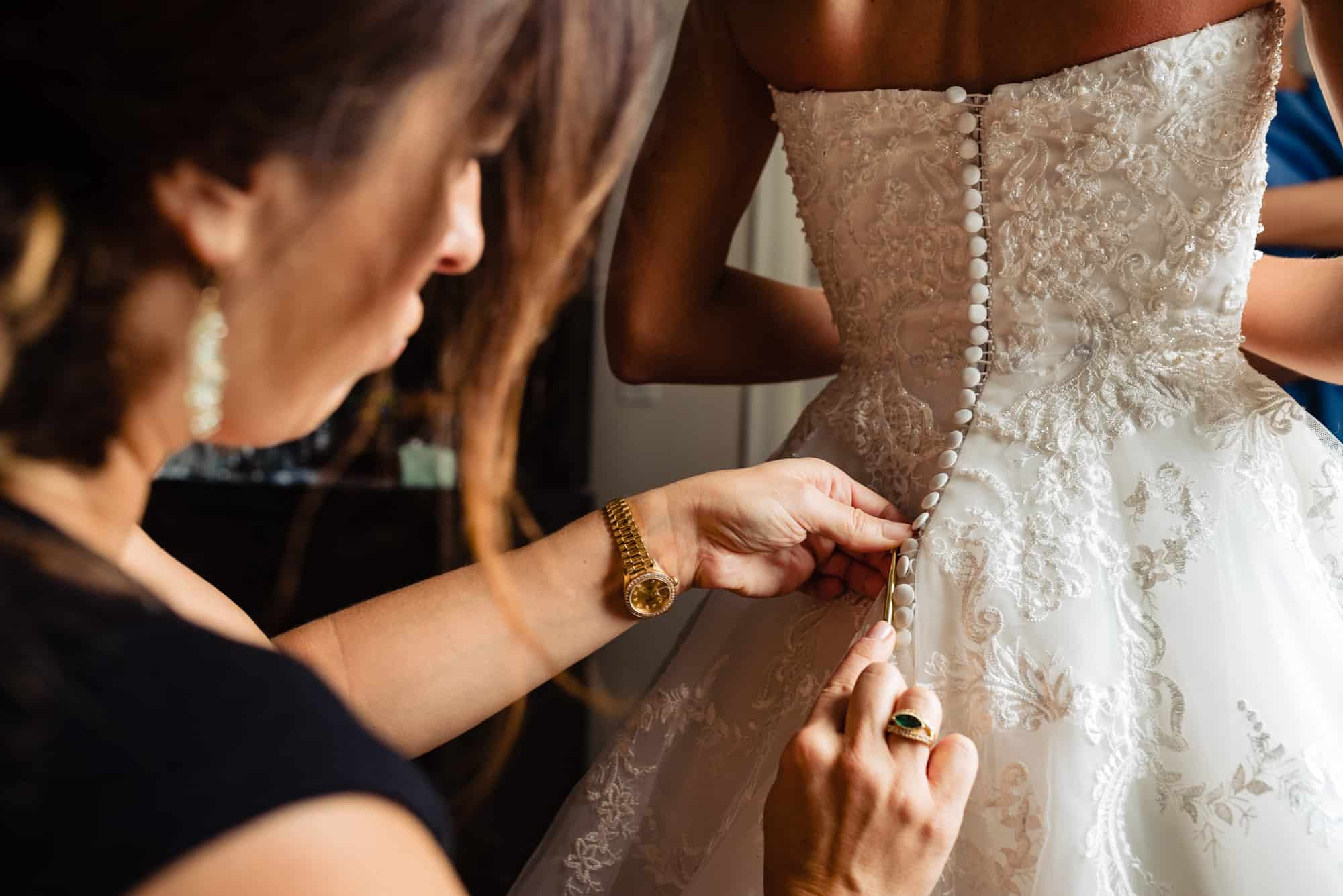 Ritz Carlton Philadelphia Wedding|bride being buttoned by Gina Sole of Instyle Planners