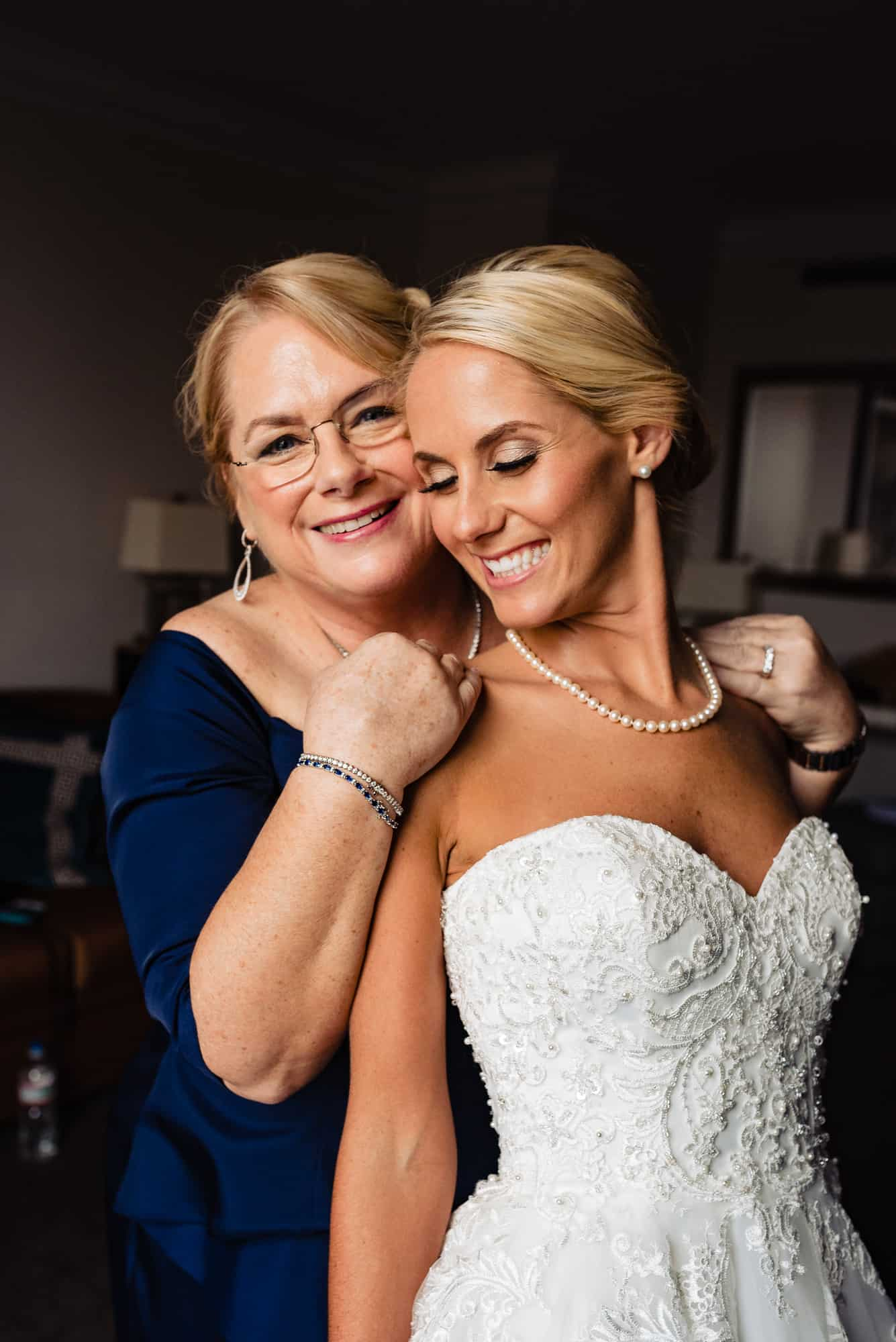 Ritz Carlton Philadelphia Wedding|mother of the bride hugging bride