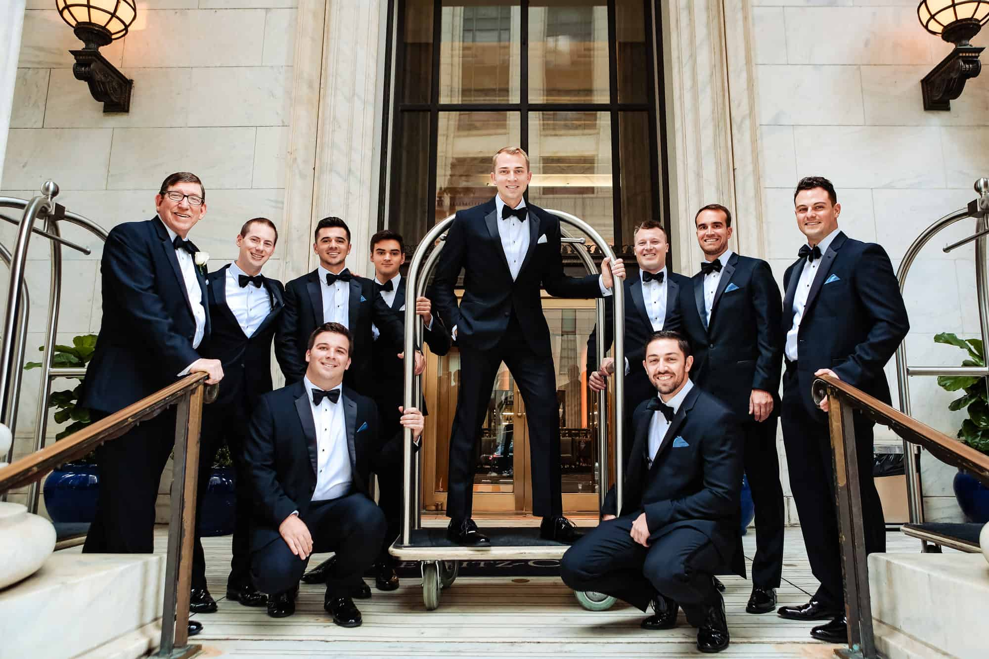 Ritz Carlton Philadelphia Wedding|groom and groomsmen using luggage cart for photo