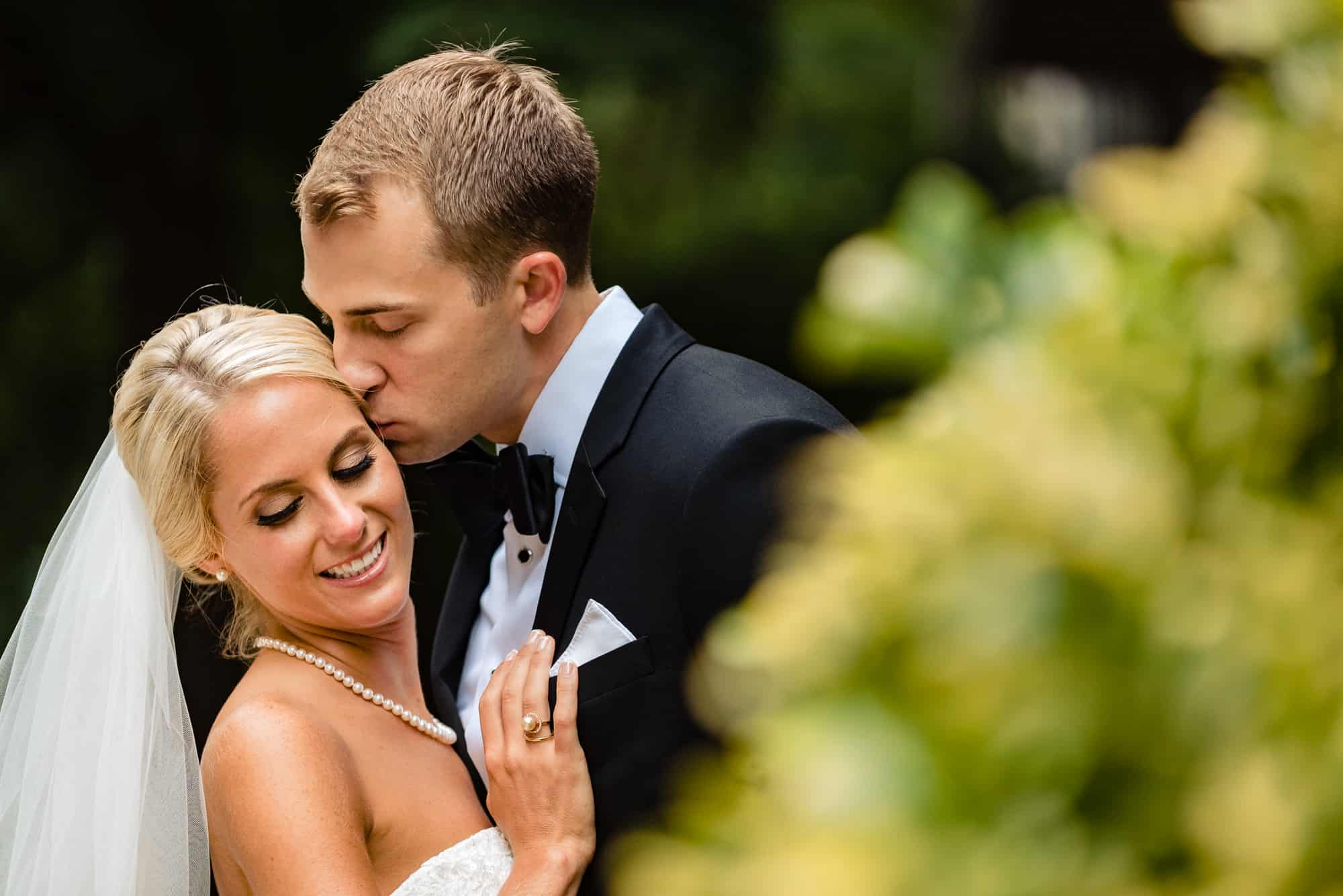 Ritz Carlton Philadelphia Wedding|groom kissing brides cheek
