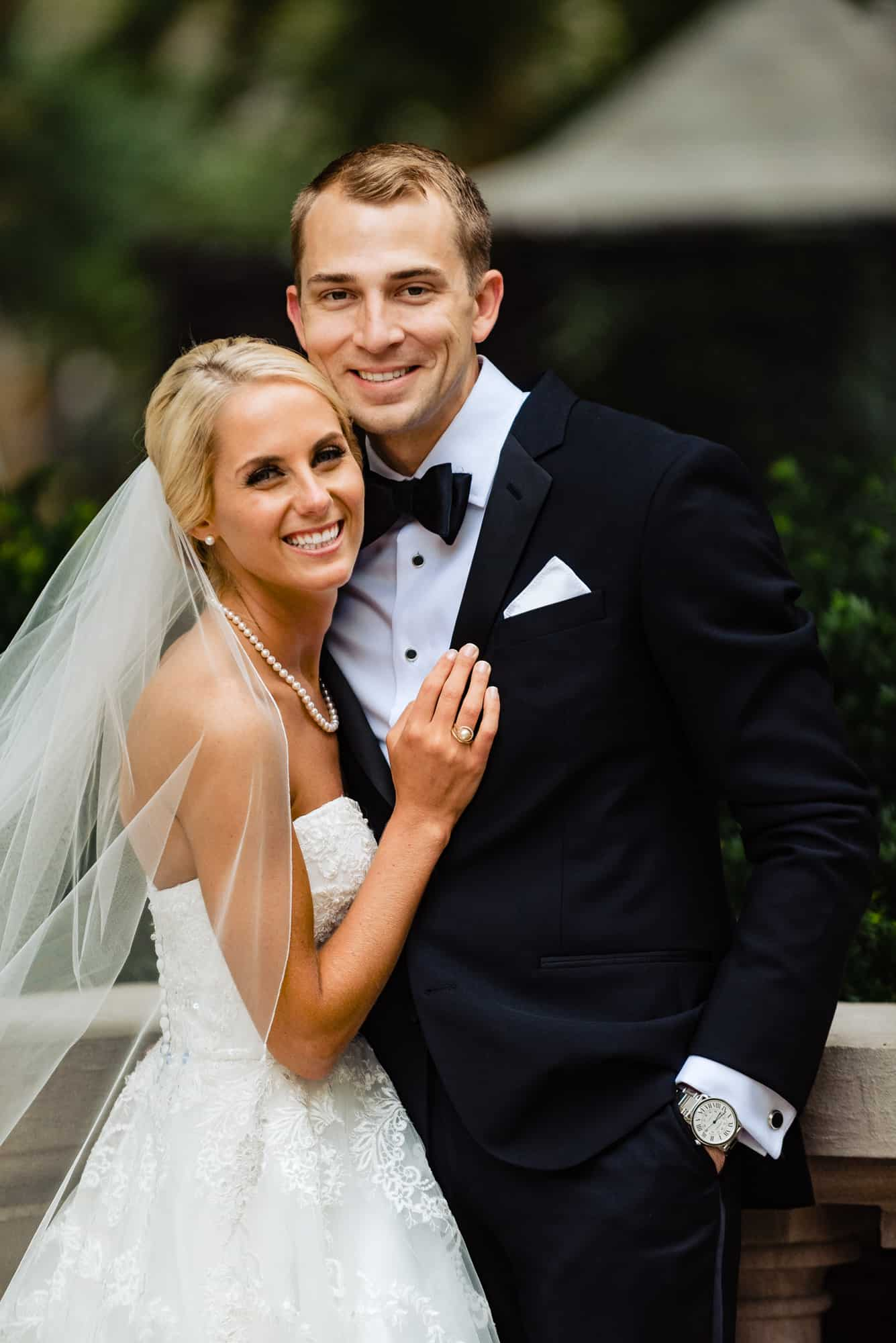 Ritz Carlton Philadelphia Wedding|bride and groom embracing looking at camera