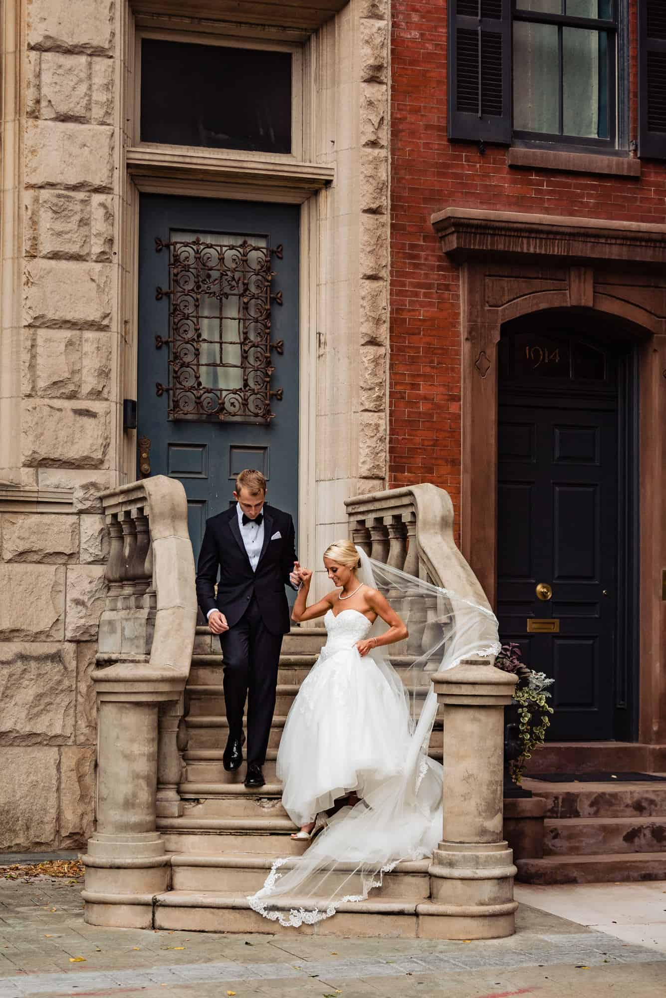 Ritz Carlton Philadelphia Wedding|bride and groom holding hands walking down stairs
